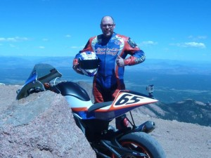 Adam Bauer at the top of Pikes Peak after his 12:16 run finishing 7th in the Middleweight Division on his ER6 Supertwin.