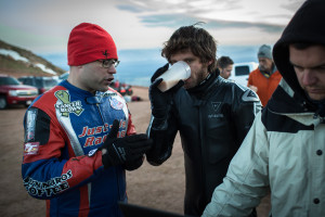 Guy Martin drinking a cuppa tea while Adam is chatting with him about his custom Martek!